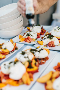 A course served at July's Dinner on Young Family Farm featuring ROMA Farm's heirloom tomatoes & Young Family Farm's peaches.
