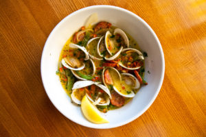 Brick Alley Pub's Portuguese Littlenecks, featuring local littleneck clams and chourico.