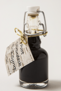 A small bottle of birch syrup produced at Cornell University's Uihlein Forest in Lake Placid. When sold for $5 in a 40 ml bottle, this equates to approximately $500/gallon on a retail basis. Photo by Nancie Battaglia.