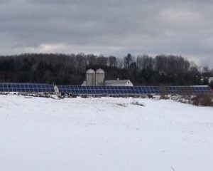 McKnight Farm solar array in East Montpelier, showing about one quarter of the 1.5-acre array, which is rated at approximately 95 kilowatts power output. The system was built by Catamount Solar. Credit: Catamount Solar