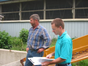 Jim Carrabba (right) of NYCAMH doing an on-farm safety/health walkthrough with a farm manager (photo by NYCAMH staff).