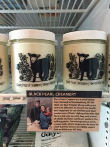 Black Pearl Creamery Sheeps Milk Yogurt has a plaque dedicated to the description of the farm and a photo of the owners.