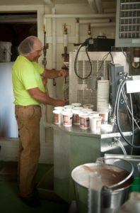 Donn Cann pours Cobb Hill Frozen Yogurt. Credit: Robert Eddy