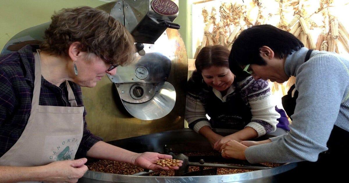 Three people looking at seed