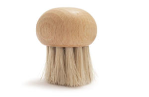 a round wooden brush with course bristles.